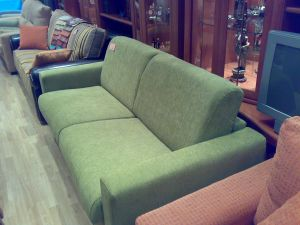 Sofa cama en color verde.