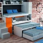 Dormitorios Modulares en blanco y naranja con camas abiertas