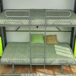 Dormitorios Modulares en blanco y verde camas abiertas